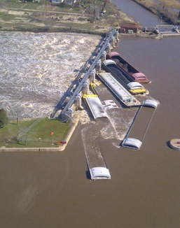 Seven barges broke free at the Marseilles Dam.