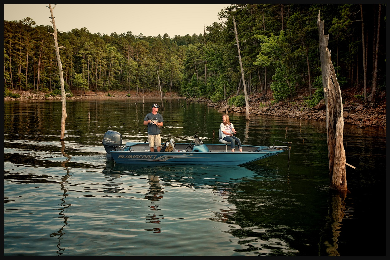 Adults fishing on a boat